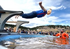 "BEST 1. Dan Calter, dressed as ""Sloth"" from the movie Goonies, belly flops into the pool during the polar plunge at Frozen Dead Guy Days on Saturday in Nederland. For more photos of the event go to www.dailycamera.com Jeremy Papasso / Staff Photographer March 12, 2016"
