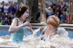Sonya Dimitrova, left, and Whiley Hall react after taking the polar plunge during Frozen Dead Guy Days on Saturday in Nederland. For more photos of the event go to www.dailycamera.com Jeremy Papasso / Staff Photographer March 12, 2016